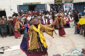Mask dance performing by monks in mustang